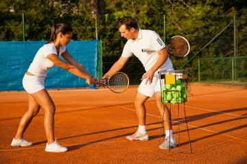 tennis instructor teaching