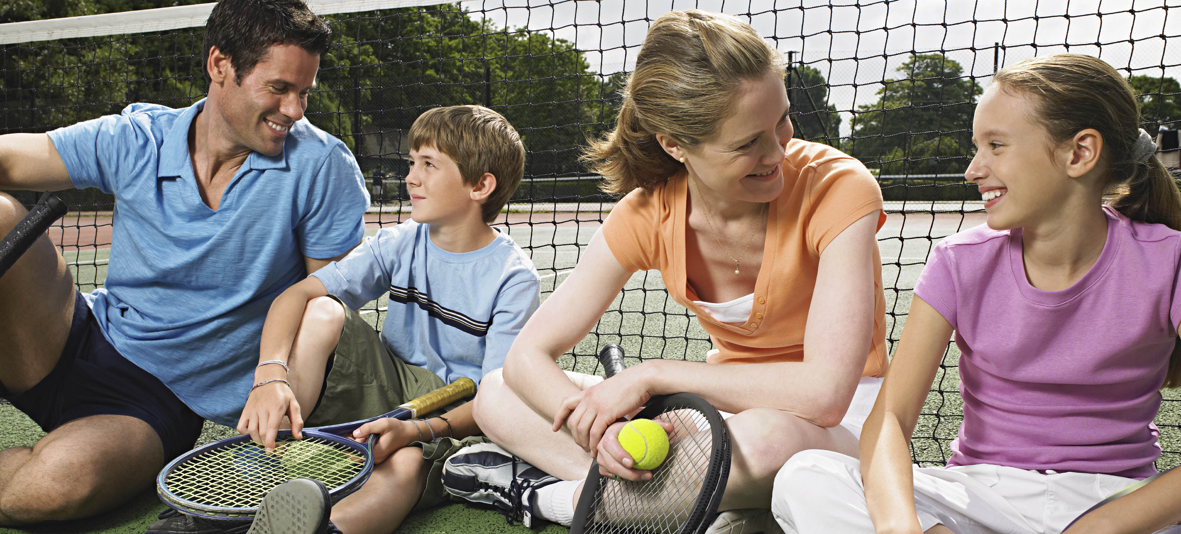 Spend Quality Time With Your Family Playing Tennis